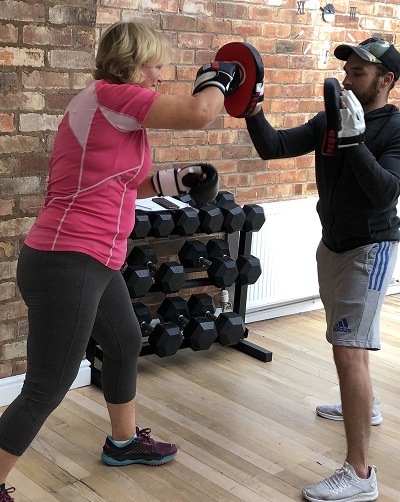 Fit Friends' personal trainer Loughborough, punching pads image
